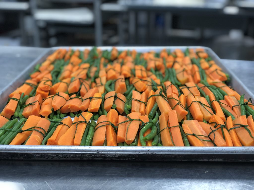 Carrot and pea bundles